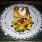 breakfast quiche with fresh fruit salad