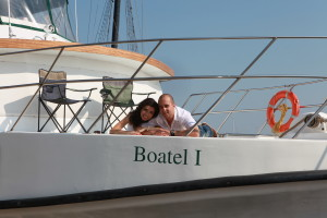 a young couple laying down on the bow of the Boatel