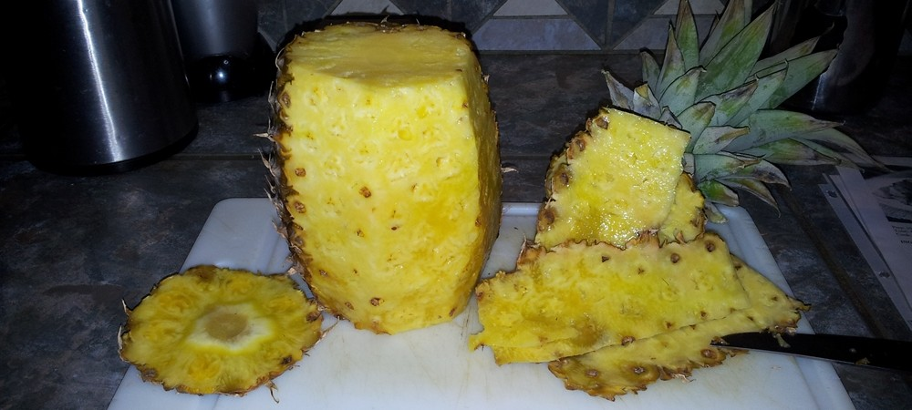 Pineapple being cut